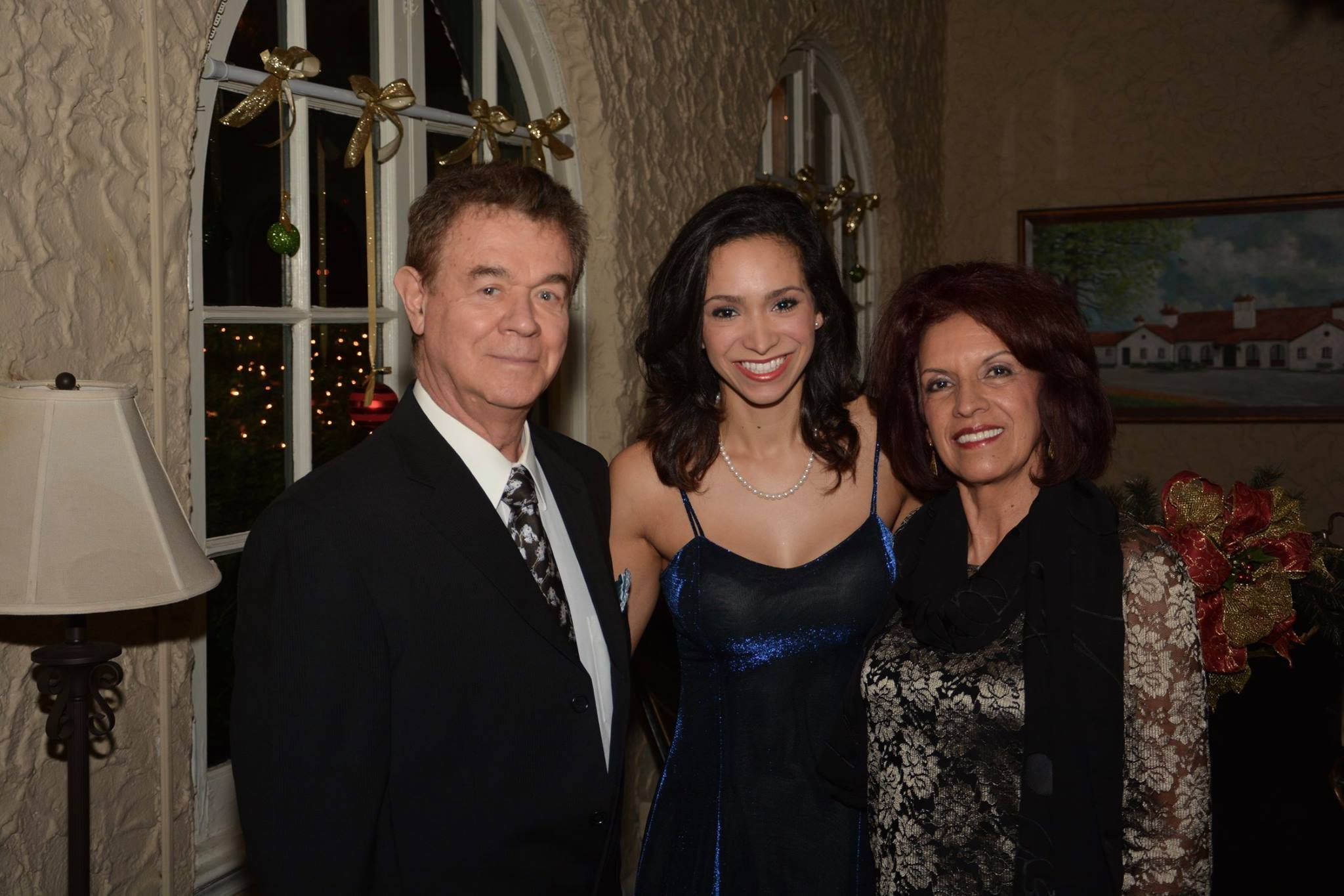 Juliana with her parents, who will be there to see her dance.