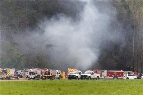 Emergency vehicles respond to the scene of a fatal helicopter crash, Monday, April 4, 2016, in Pigeon Forge, Tenn. A sightseeing helicopter crashed near the Great Smoky Mountains National Park, officials said. (Knoxville News Sentinel via AP)