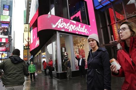 In this Wednesday, Dec. 2, 2015, file photo, women pass an Aeropostale clothing store in New York's Times Square. (AP Photo)