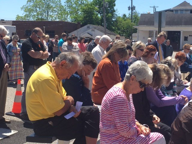 Folks bow their heads during a National Day of Prayer service in Obion County.