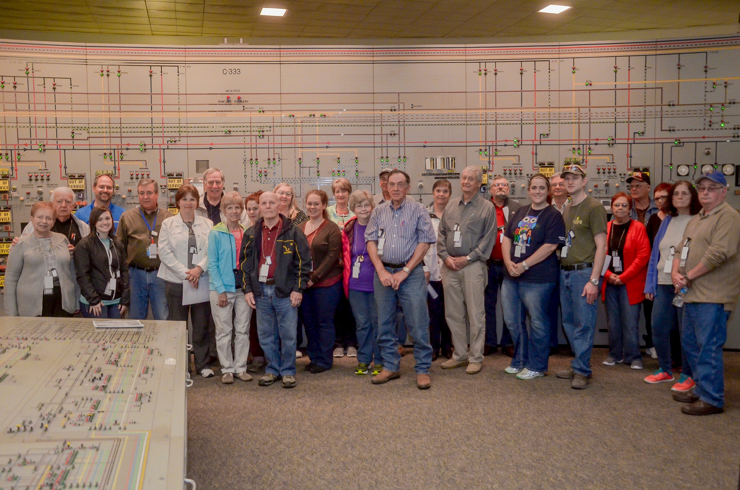 Tour participants stopped for a picture in the C-300 Central Control Facility at the Paducah DOE site during the inaugural community tour on April 23, 2016. (Contributed photo)