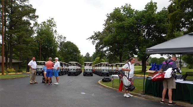 Golfers start to gather for the event that hosted 35, four person teams.