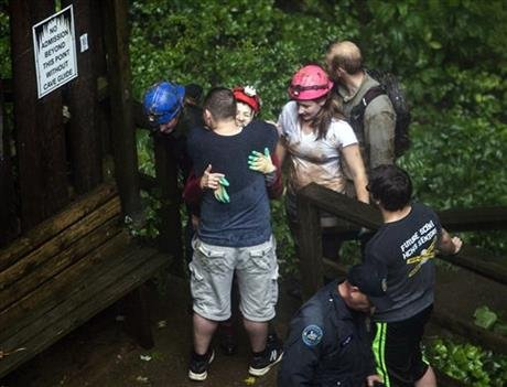Tour guide Peggy Nims hugs a friend after she made it out of Hidden River Cave after officials said over a dozen people who were exploring the cave were trapped by rising water Thursday, May 26, 2016, in Horse Cave, Ky. (Daily News via AP)