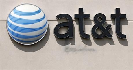 In this May 14, 2014 file photo, an AT&T logo is seen on a store in Dedham, Mass. (AP photo)