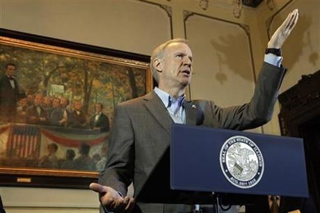In this Monday, June 27, 2016 photo, Illinois Gov. Bruce Rauner speaks to reporters about the state budget and education funding, in his office at the Illinois State Capitol in Springfield, Ill. (AP photo)
