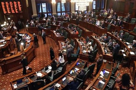 Illinois lawmakers debate legislation while on the House floor during session at the Illinois State Capitol Thursday, June 30, 2016, in Springfield, Ill. (AP photo)