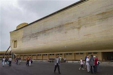 Visitors roam the Ark Encounter theme park as a replica of Noah's Ark stands in the background during a media preview day, Tuesday, July 5, 2016, in Williamstown, Ky. (AP photo)