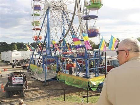 Law enforcement cordon off the area surrounding the Ferris wheel Monday, Aug. 8, 2016, after three people fell from the ride during a county fair in Greenville, Tenn. (The Greeneville Sun via AP)