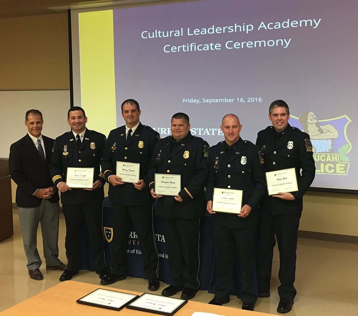 Chief Brandon Barnhill, Assistant Chief Brian Krueger, Capt. Anthony Copeland, Sgt. Chris Baxter, Officer Shawn Craven and Officer Austin Guill