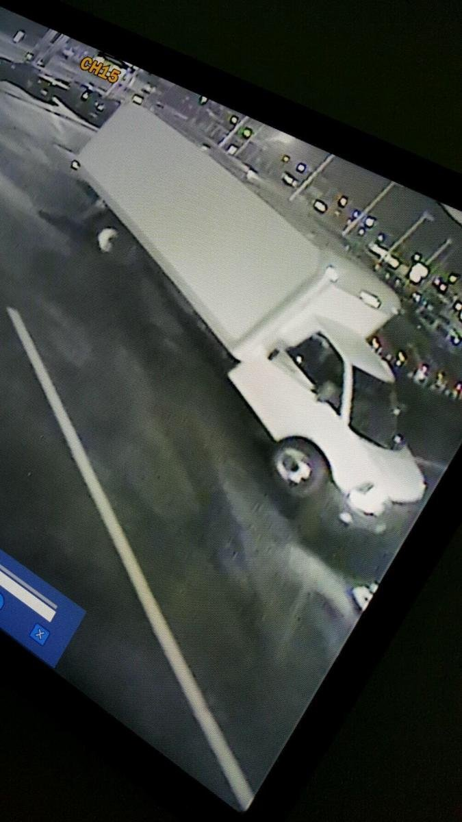 Carbondale police took this photo of a surveillance image, shown on a computer screen, of a truck offers say was used to steal tires and rims from SUVs at two dealerships.