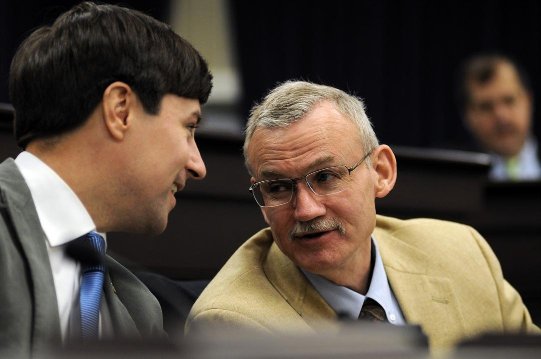 State Rep. Gerald Watkins, right, talks with state Rep. James Kay of Versailles during a recent committee meeting in Frankfort.
