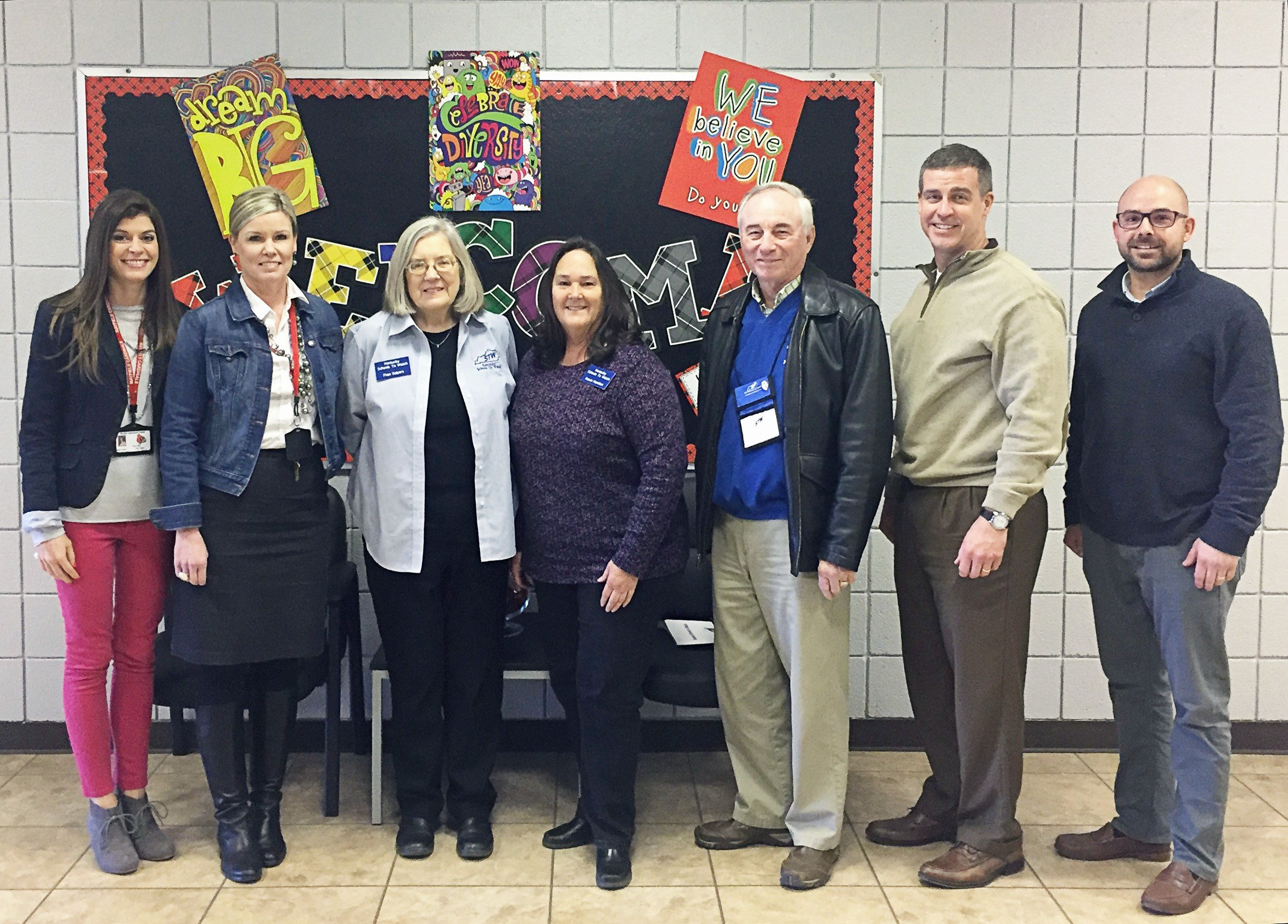 This photo shows, from the left, Mayfield Middle School Assistant Principal Kelly Stinson, Principal Kim Reed, and National Schools to Watch Review team members Fran Salyers, Karen Hamilton, Steve Tribble, David Ward and Tim Bundren.