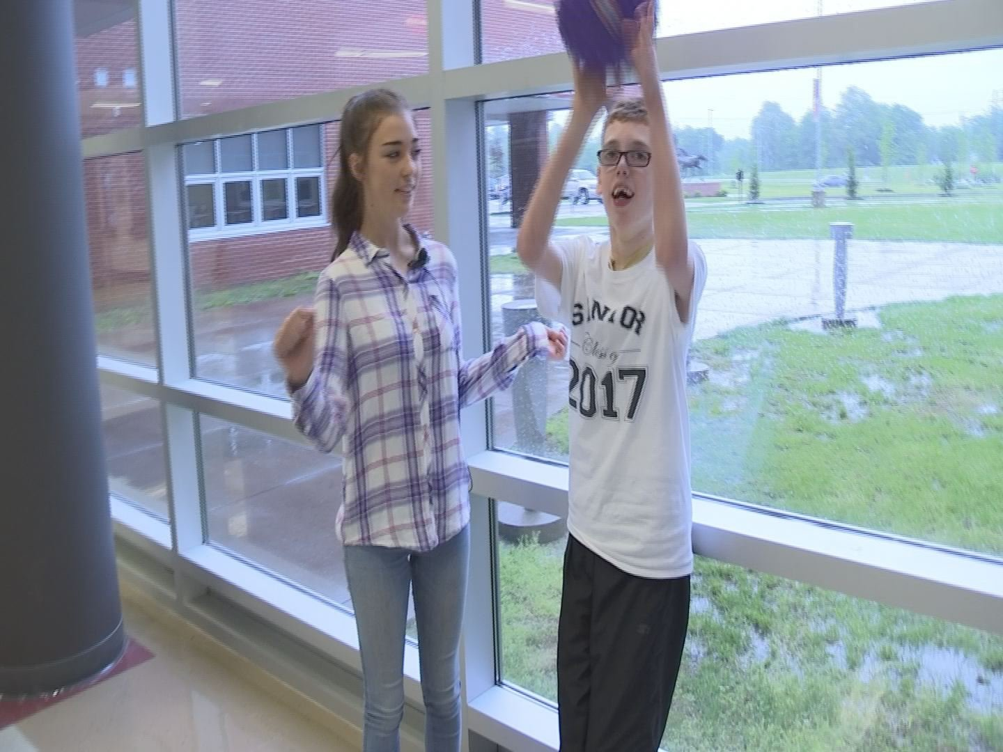Matthew works on important physical skills, like throwing this ball, in the hallway at MCHS with his peer tutor, Camille Baker.