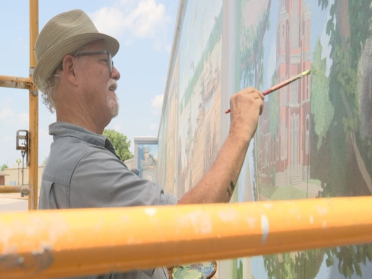 Artists are restoring and redoing murals in downtown Paducah.