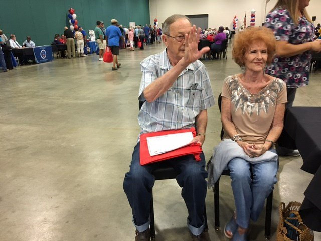 Former nuclear workers gather at the Julian Carroll Convention Center to find out what benefits they deserve.