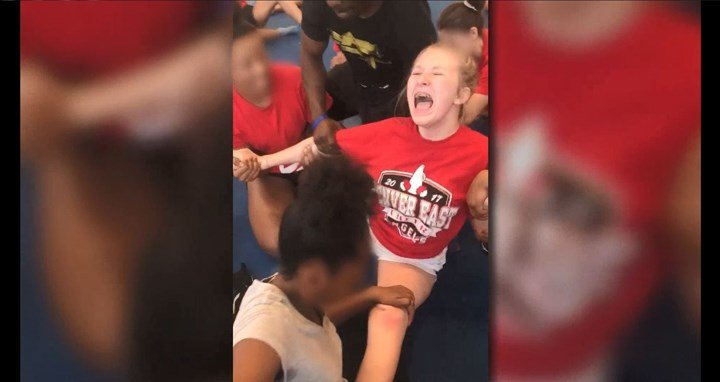 Video shows high school cheerleaders held down, forced into splits