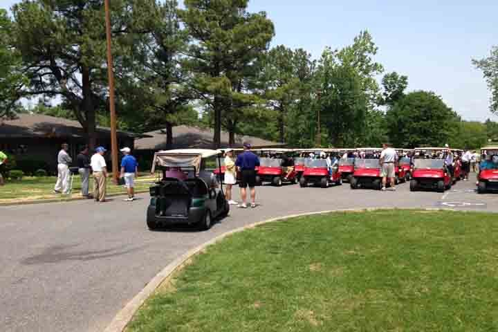 Golfers prepare their golf carts before heading out