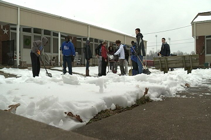 A group of about 40 Paducah Tilghman High School track team members helped shovel and ice and snow from walkways at Elmdale Court subsidized housing Thursday.