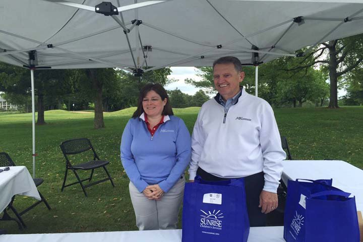 Phil Justice with Sunrise Children's Services and Beth Trimble with A&K Construction were among those raising money for abused and neglected children in Kentucky at the golf tournament.