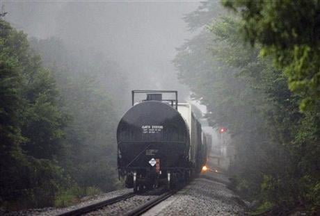 Flames are shown coming from a CSX train carrying flammable and toxic gas in Maryville, Tenn., Thursday, July 2, 2015. (Knoxville News Sentinel via AP)