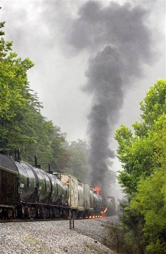 Smoke rises from a CSX train carrying flammable and toxic gas in Maryville, Tenn., Thursday, July 2, 2015. (Knoxville News Sentinel via AP)