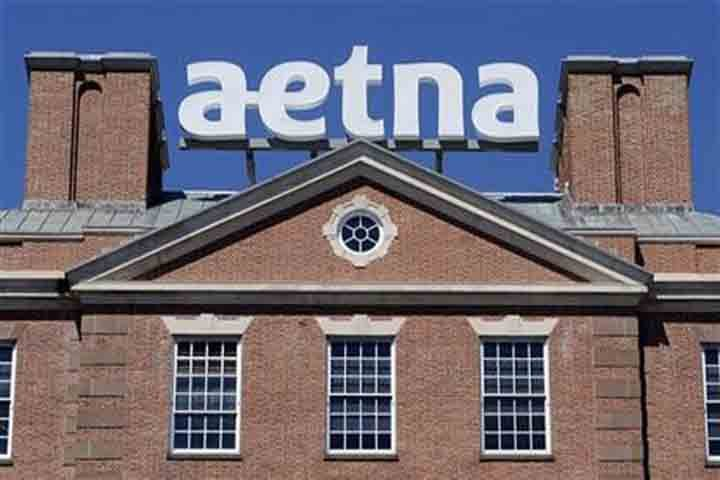In this Aug. 19, 2014, file photo, a sign stands at Aetna headquarters in Hartford, Conn. (AP photo)
