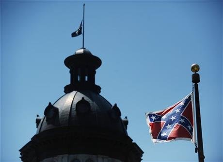 In this June 19, 2015 file photo, the Confederate flag flies near the South Carolina Statehouse in Columbia, S.C. (AP photo)