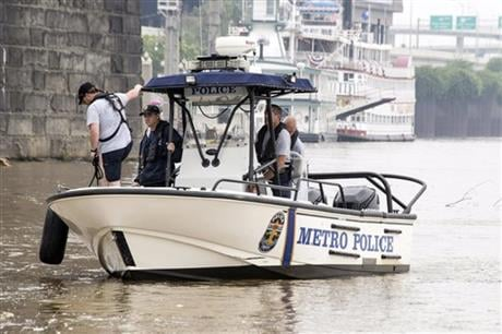 Authorities stand on a Louisville Metro Police Department boat, Sunday, July 5, 2015, on the Ohio River in Louisville, Ky. (The Courier-Journal via AP)