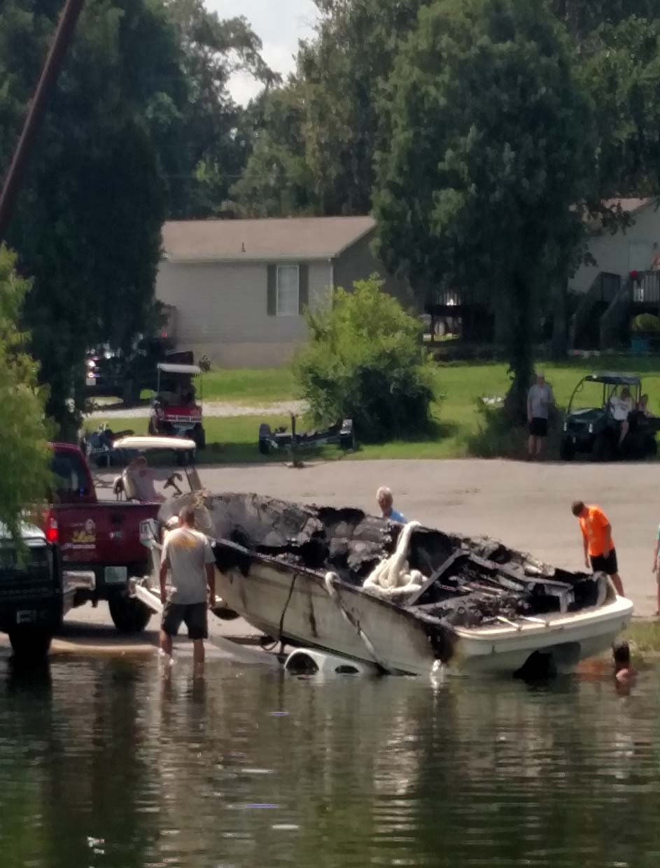 The boat was placed on a trailer for inspection when it was retrieved Monday. Photo contributed by Judy Johnson.