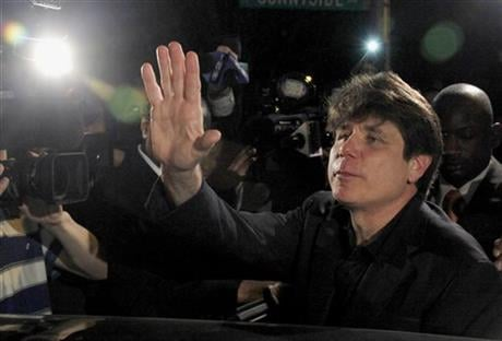 In this March 15, 2012 file photo, former Illinois Gov. Rod Blagojevich waves as he departs his Chicago home for Littleton, Colo., to begin his 14-year prison sentence on corruption charges.  (AP)