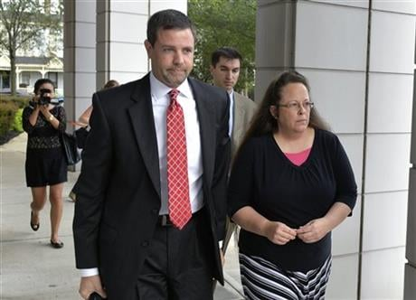 In this July 20, 2015 file photo, Rowan County Clerk Kim Davis, right, walks with her attorney Roger Gannam into the United States District Court for the Eastern District of Kentucky in Covington, Ky. (AP photo)