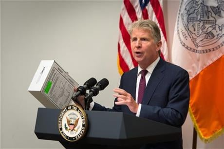 Manhattan District Attorney Cyrus Vance shows a sexual assault kit during a press conference at the Office of the Chief Medical Examiner Thursday, Sept. 10, 2015, in New York. (AP photo)