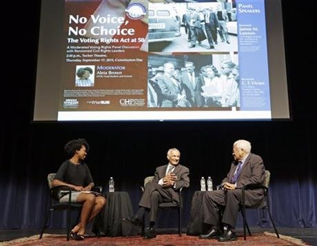 Rev. C.T. Vivian, center, and Rev. James Lawson, right, take part in a discussion at Middle Tennessee State University about the Voting Rights Act Thursday, Sept. 17, 2015, in Murfreesboro, Tenn. At left is moderator Aleia Brown. (AP Photo)
