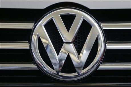 In this photo taken Feb. 14, 2013, a Volkswagen logo is seen on the grill of a Volkswagen on display in Pittsburgh.  (AP photo)