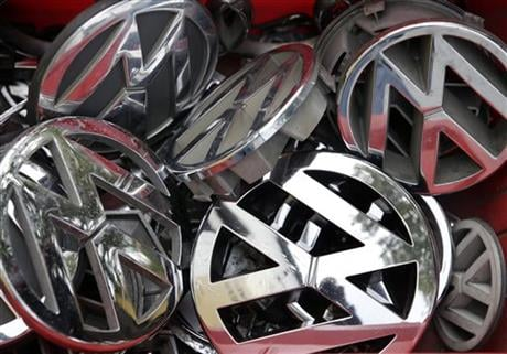 Volkswagen ornaments sit in a box in a scrap yard in Berlin, Germany, Wednesday, Sept. 23, 2015. (AP photo)