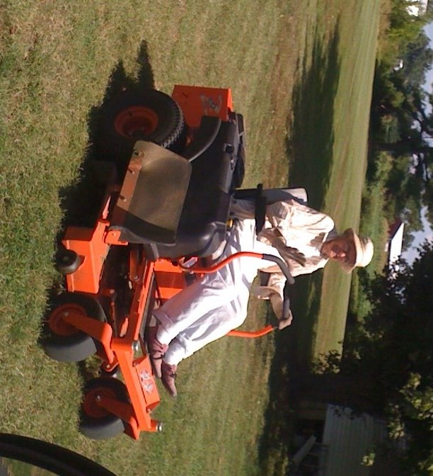Helen Adams enjoys her birthday present, a zero-turn Bad Boy mower, from her son.
