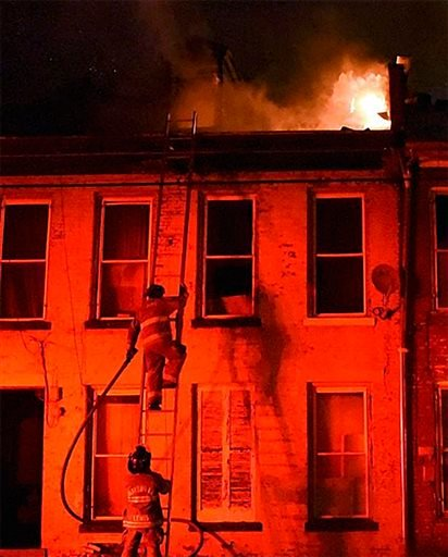 Firefighters work Tuesday, Oct. 20, 2015, in Marysville, Ky. Maysville Mayor David Cartmell says two adults and three children have been killed in a fire at a set of apartment buildings. (Ledger Independent via AP)