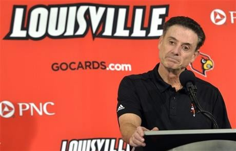 In this Oct. 3, 2015, file photo, Louisville head coach Rick Pitino responds to a question following an NCAA college basketball team's intrasquad scrimmage in Louisville, Ky. (AP photo)