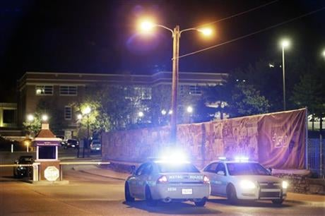 Police guard the main entrance to Tennessee State University early Friday, OCt. 23, 2015, while officials investigate the scene of a Thursday shooting on the campus in Nashville, Tenn. (AP photo)