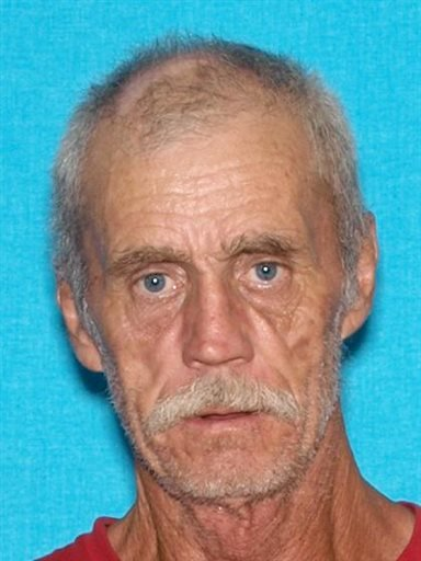 Floyd Ray Cook is seen in an undated photo provided by the Kentucky State Police. A manhunt is underway for Cook, who is accused of shooting and wounding a Tennessee police officer and then firing at a state trooper in Kentucky. (KSP via AP)
