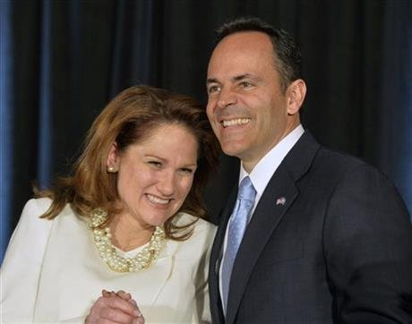 Kentucky Republican Gov.-elect Matt Bevin, right, and his wife Glenna react to the cheers of supporters during his introduction at the Republican Party victory celebration, Tuesday, Nov. 3, 2015, in Louisville, Ky. (AP photo)