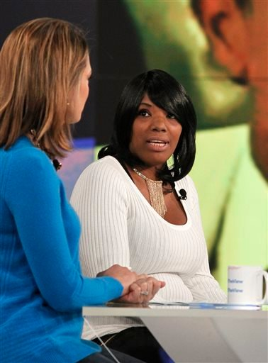"""In this Friday, Oct. 23, 2015 file photo provided by ABC, Katina Powell, right, appears on ABC's """"The View"""" with host Paula Faris, left, in New York. (ABC via AP)"""
