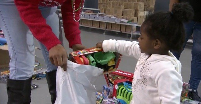 A little girl picks out a toy. The American Red Cross and other volunteers came together to make sure people impacted by tornadoes had a merry Christmas.