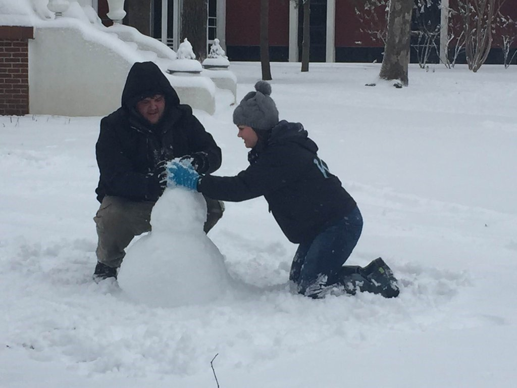 Murray State students who didn't make it home for the weekend build snowmen in front of the MSU president's home.