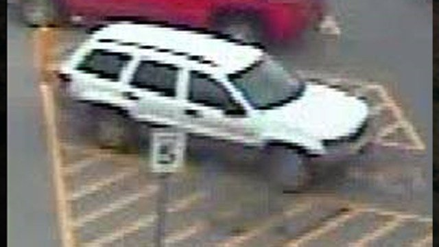 Two men are suspected of stealing merchandise from the Marion, IL Walmart on December 31, 2015, then loading it into this white SUV.