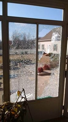 This window was broken when, a report from the Kentucky State Police Forensic Lab said, a Paducah police rifle shot two bullets into a Graves County home.