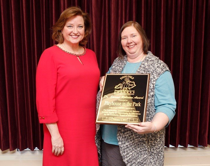 Receiving the Dr. Samuel Robinson Award were Holly Bloodworth, left, director of the playhouse's Penguin Project, and Lisa Cope, executive director of the playhouse.